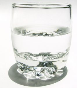 glass of water half filled. A visual aid to remind people to drink water and make sure they don't get dehydrated